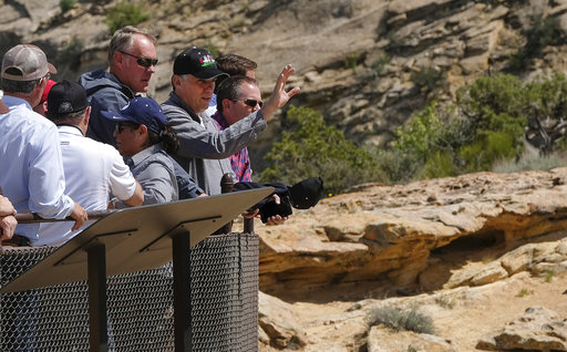 U.S. Interior Secretary Ryan Zinke is joined by San Juan County Commission Chairman Phil Lyman as he overlooks the Butler Wash Indian Ruins within the Bears Ears National Monument in Utah on Monday.