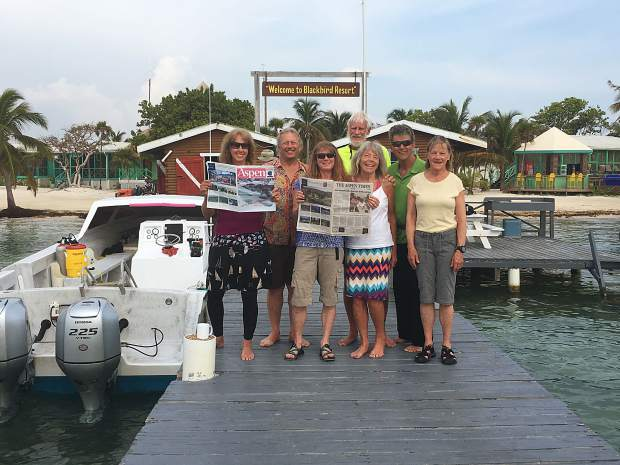 A group of Aspen-area residents, led by Tom Miller (beard, bright shirt) and Becca Magill (white shirt, skirt) brought copies of both The Aspen Times and the Aspen Times Weekly on a visit to Blackbird Cay Resort in Belize.