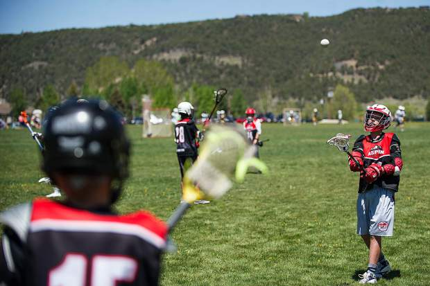 U13 Aspen Lacrosse Club boys warm up before playing agains Grand Valley Saturday afternoon at the Crown Mountain Park in El Jebel on Saturday.