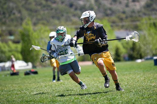 A U15 Roaring Fork Valley Lacrosse player breaks away from a Grand Valley player Saturday at the Crown Mountain Park in El Jebel on Saturday.