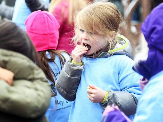 A child takes a bite of her cookie at the end of Thursday's Children's Parade in downtown Aspen. The 27th annual event is put on by Kids First in honor of May being the Month of the Young Child.