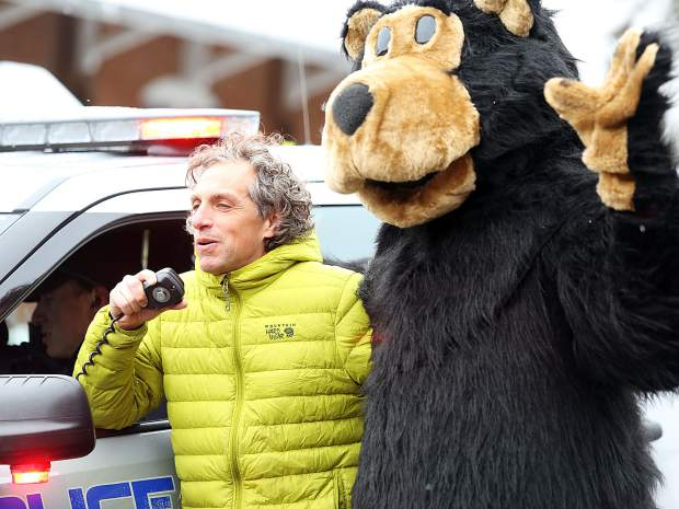 Aspen Mayor Steve Skadron recieves some help as he gets Thursday's Children's Parade underway in downtown Aspen. The 27th annual event is put on by Kids First in honor of May being the Month of the Young Child.