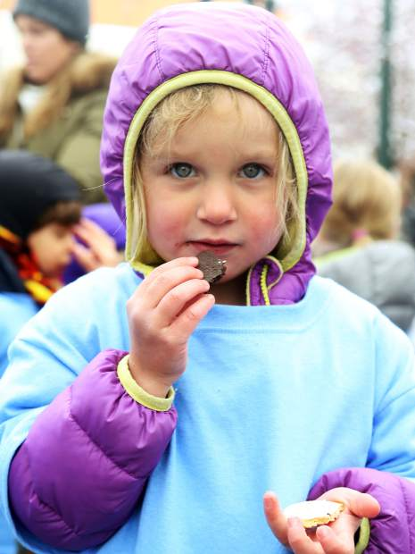 A child stares down the camera while enjoying her cookie following Thursday's Children's Parade in downtown Aspen.