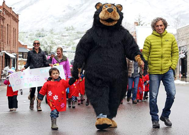 Johnny, Keith the Bear and Aspen Mayor Steve Skadron lead the way during Thurday's Children's Parade in Aspen. The 27th annual event is put on by Kids First in honor of May being the Month of the Young Child.