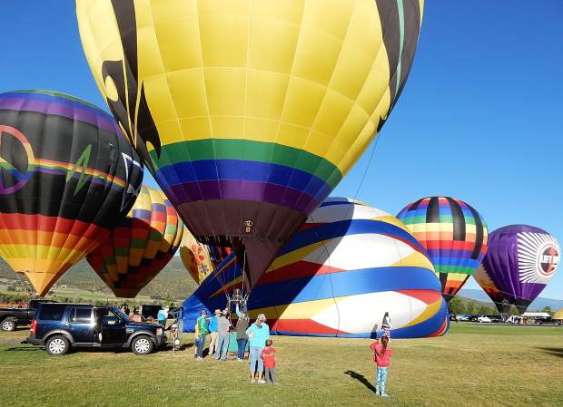 The first of a baker's dozen balloons prepares to ascend Sunday morning at Lift Off 4 Lift-Up at Crown Mountain Park in El Jebel.