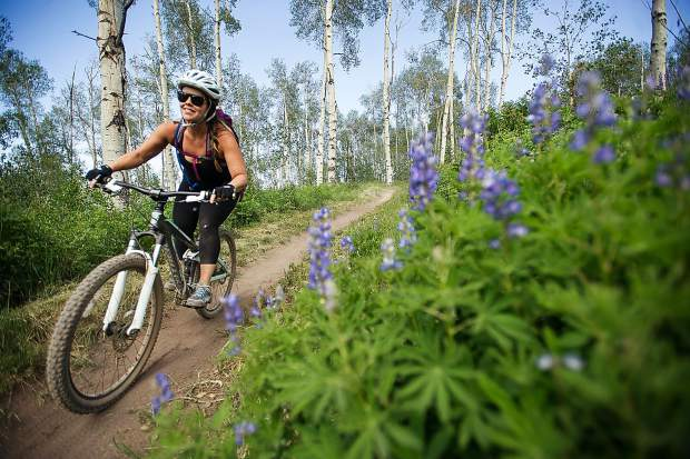 Geneva Vaughn rides her mountain bike on the Verde Trail at Snowmass for the opening day of their downhill bike park on Friday.