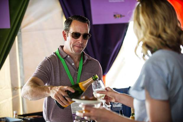 Wine is poured at a booth in the Spanish tent at the first grand tasting in Aspen on Friday.