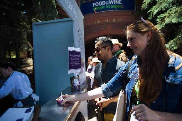 Sara Stookey and fiance Hugo Sanchez get a delicious ice cream from the NoMad Truck outside of the St. Regis Friday for the Aspen Food and Wine Classic.
