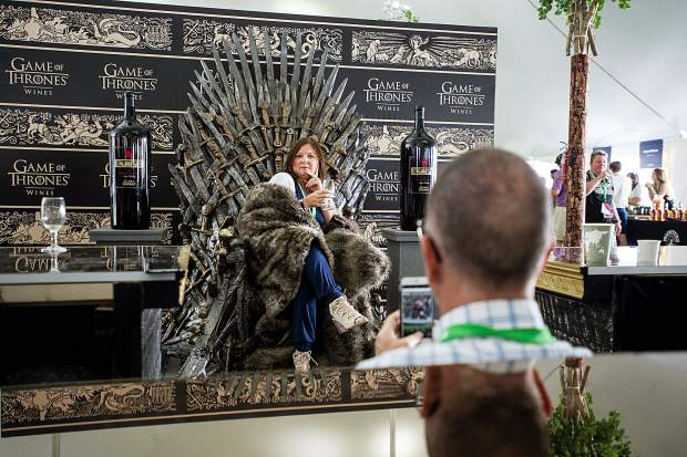 President of the Aspen Chamber Debbie Braun poses in the Game of Thrones' chair at the first Grand Tasting at the Food and Wine Classic in Aspen on Friday.