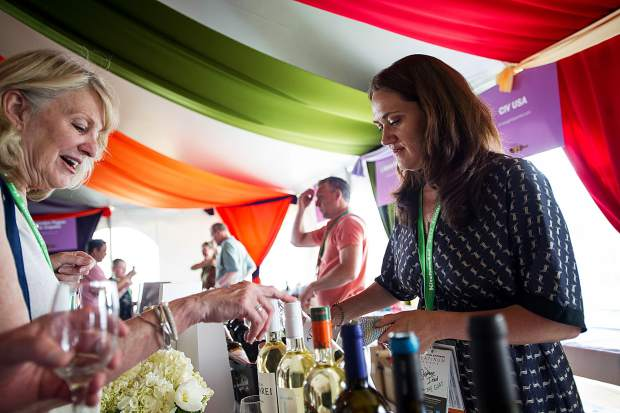 Trish Heywood discusses DO Rias Baixas wines with a patron in the Spanish Wines tent at the first Grand Tasting of this year's Food and Wine Classic in Aspen on Friday.