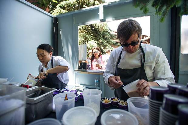Chefs Mark Welker and Becky Quan prepare ice cream from the NoMad Truck outside of the St. Regis Friday for the Aspen Food and Wine Classic.