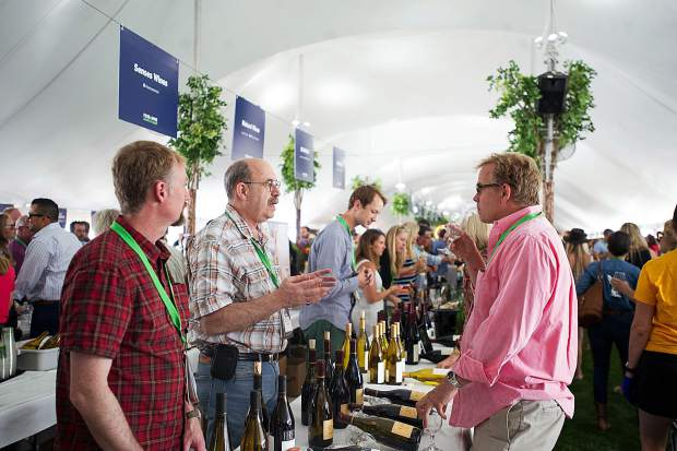 Patrons discuss wine with different booths at the first Grand Tasting of the Aspen Food and Wine Classic on Friday.