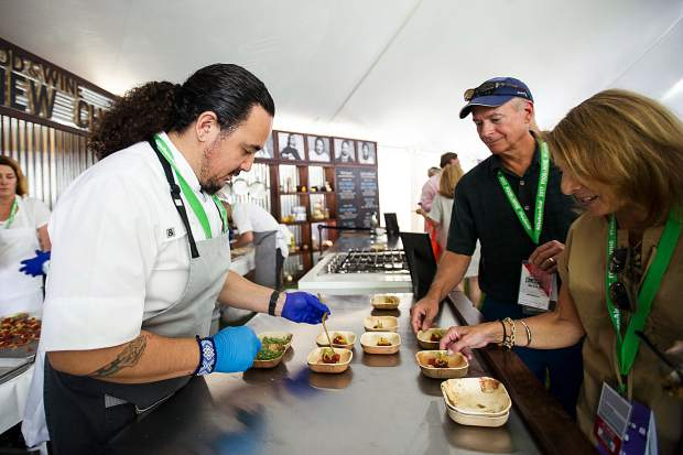 Rico Torres prepares yellowfin tuna crudo tostadas with cacao and dried chilis, pickled pineapple, and leche de tigre for the first Grand Tasting at the Food and Wine Classic in Aspen on Friday.