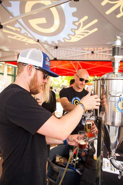 Steve Nolan of Grist Brewing Company out of Highlands Ranch at the Snowmass Rendezvous Craft Beer Festival on Saturday.