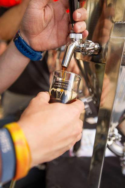 Steve Nolan of Grist Brewing Company out of Highlands Ranch pours a beer at the Snowmass Rendezvous Craft Beer Festival on Saturday.