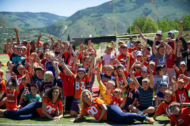 A group photo after the Broncos' football camp at Aspen High School on Saturday.
