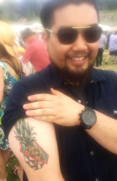 Aspen chef David Wang shows off his new tattoo of a pineapple.