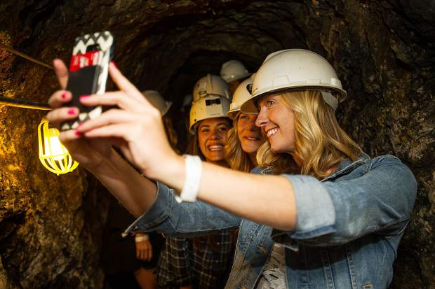 A group takes a selfie during the mine tour at the Saturday night from the Infinite Monkey Theorem Winery