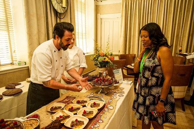 Pastry Chef Johnny Iuzzini discussing his dessert with a guest at A Bubbly Brunch at Hotel Jerome Sunday.