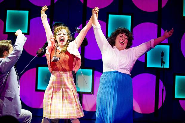 Taylor Hartsfield playing Tracy Turnblad, right, and Abigail Isom playing Penny in Aspen Theatre's production of Hairspray at their dress rehearsal June 23.