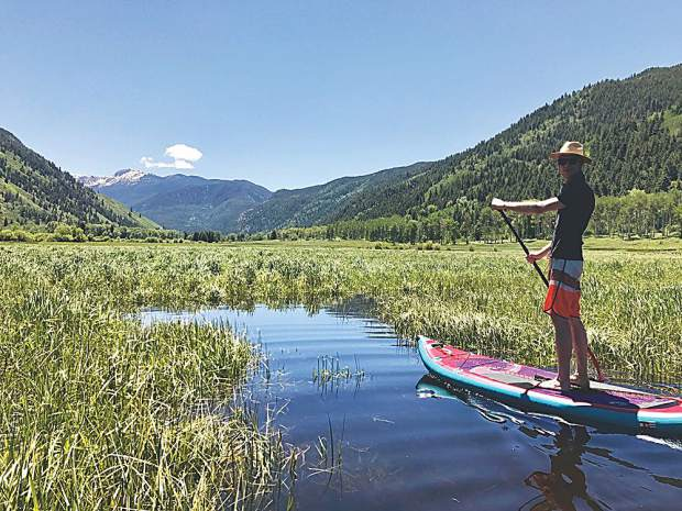 The ultimate summer day in Aspen - Stand Up Paddleboarding with friends like Clay Stranger, pictured here.