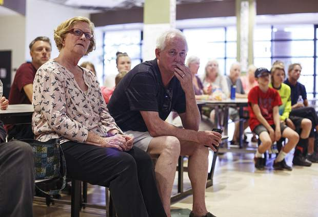 Residents who evacuated due to Peak 2 fire listen to a briefing inside Summit Middle School lobby Wednesday, July 5 in Frisco.