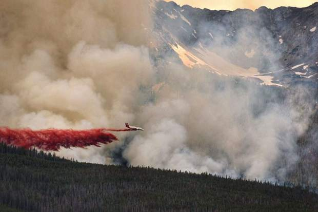 An air tanker drops flame-retardant slurry on the Peak 2 Fire near Breckenridge on Wednesday.