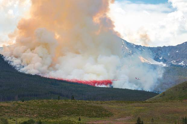 An air attack works to quell a wildland fire burning Wednesday in Breckenridge. The fire has forced the evacuation of a nearby neighborhood.