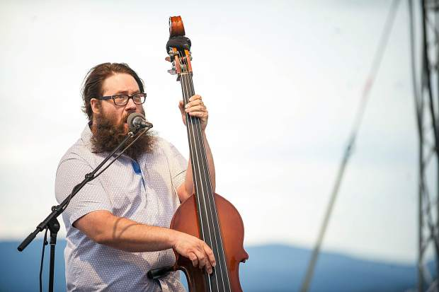 Matt Loewen of bluegrass band Head for the Hills playing on Fanny Hill in Snowmass on Thursday for the free concert.