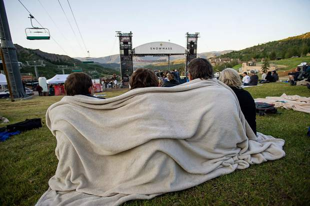 Fans huddle beneath a blanket at the Drive-By Truckers' show on Fanny Hill.