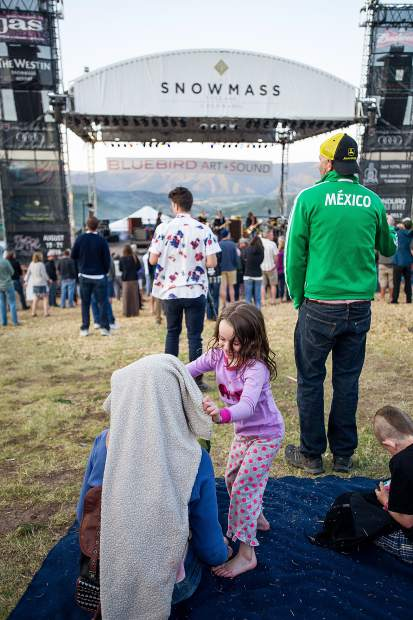 A little girl plays with her mother at the Bluebird Art and Sound concerts in Snowmass Friday evening.