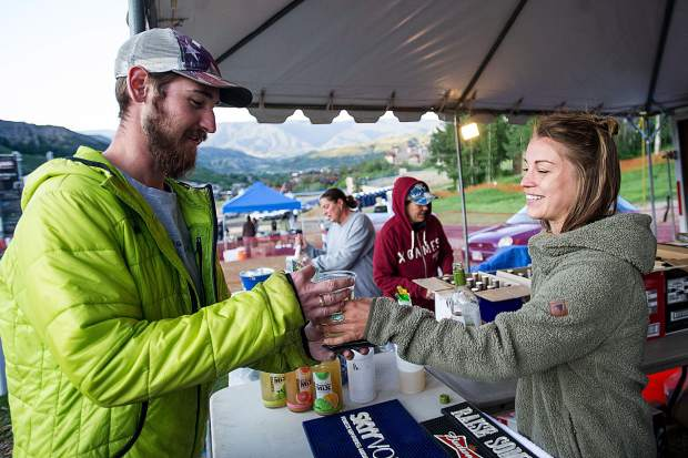 Concert-goer Andrew Shewmaker buys a glass of wine from Stephanie Janigo.