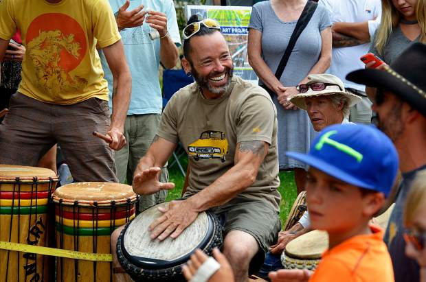 Darren Gilley leads a drum circle in a lesson in African drumming at Mountain Fair.