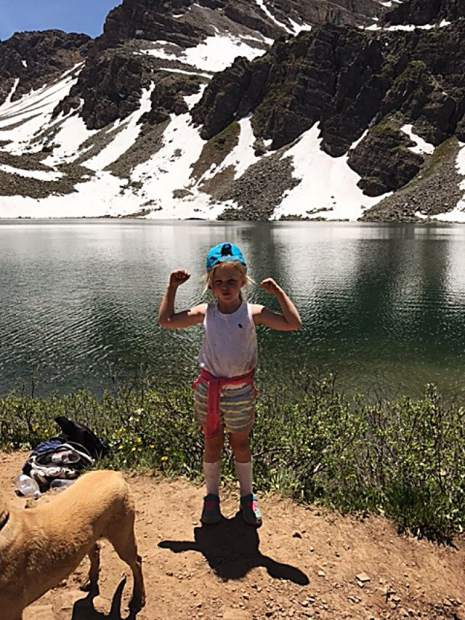 Five-year-old Brooklyn Kennedy Lewis celebrates the end of an epic hike at the top of Cathedral Lake.