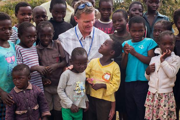 Aspen's Blake Appleby has his picture taken with a group of Zambian children in June.
