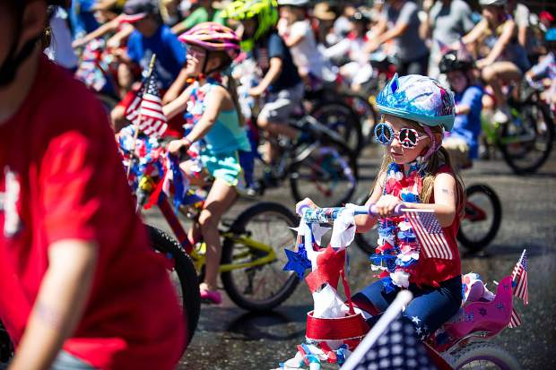A little girl in the bike parade in Aspen on Tuesday.