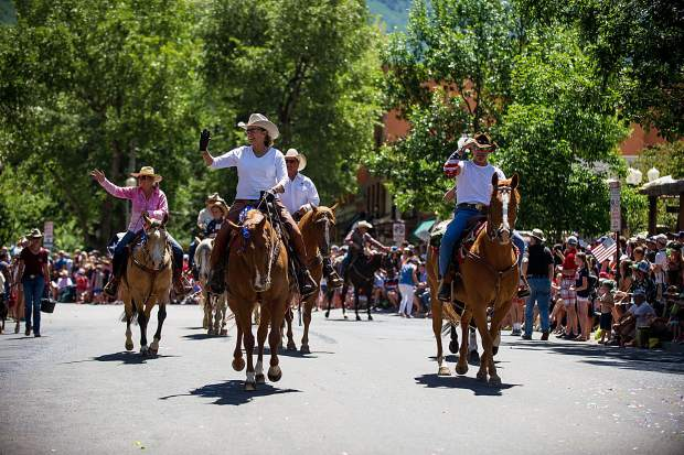 A float of horseback riders in Aspen's parade on Tuesday.