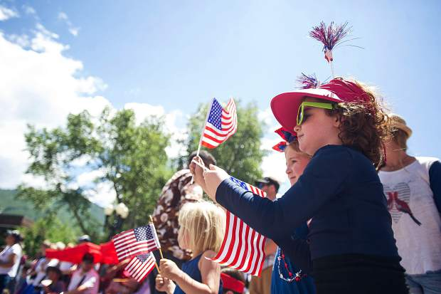 Gracie Rudolph, 7, at the parade in Aspen on Tuesday.