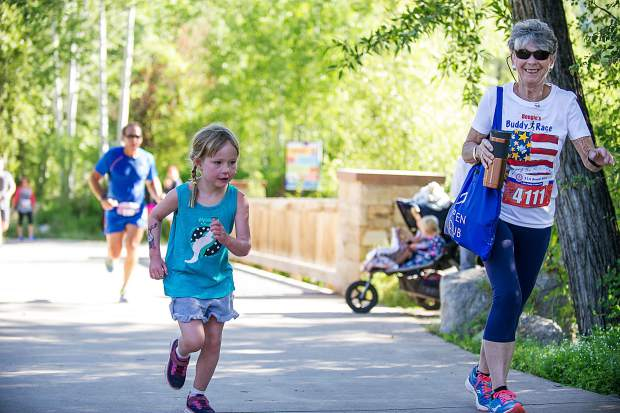 Marierose Rice, 6, and her grandmother on the Rio Grande Trail for the Boogie's Buddy Race in Aspen on Tuesday.