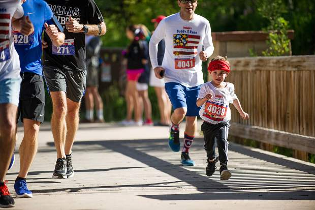 A little racer on the Rio Grande Trail in Aspen for the Boogie's Buddy Race on Tuesday.