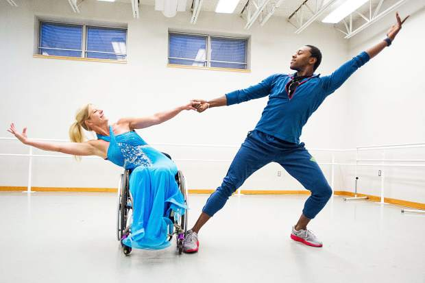 Amanda Boxtel dances on Wednesday with partner Joseph Watson II in the Aspen Santa Fe dance studio rehearsing their routine to be performed at the St. Regis ballroom tonight.