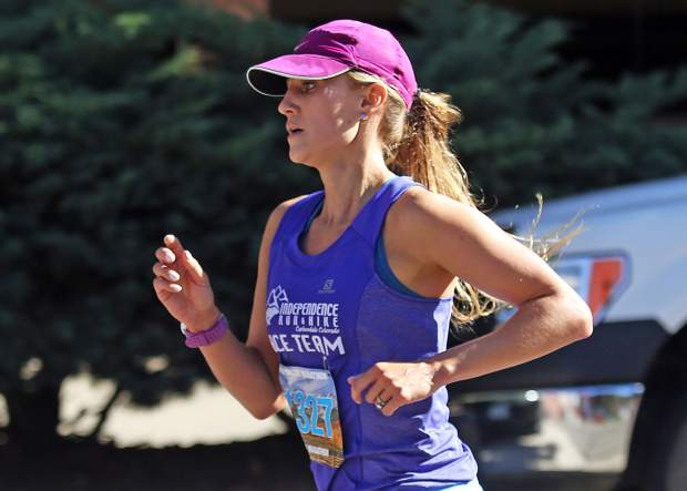 Glenwood Springs school teacher Abbey Ehlers is the first female to cross the finish line in Saturday's Aspen Valley Half Marathon in Basalt. She finished the 13.1-mile course in 1 hour, 25 minutes, 56 seconds.