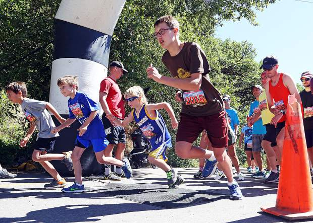 Racers take off from the start of the 5K run Saturday, part of the 2017 Aspen Valley Marathon festivities in downtown Basalt. Darren Brungardt of Leadville won the 5K race in 21 minutes, 49 seconds.