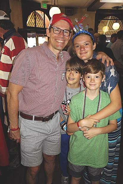 Jon Kelly celebrates Independence Day with his kids Mark, Lauren and J.J. at Justice Snow's for the YPO party.