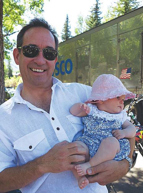 David Johnston with baby Lexi at her first 4th of July parade.