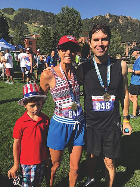 Fast family - James Connolly with his mom, Ashley, winner of the women's division and dad, Mike, who was among the top finishers in the Buddy Five-Mile footrace.