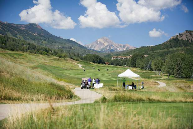 Golfers at hole 11 at the Snowmass Club for the Challenge Aspen benefit known as the Vince Gill and Amy Grant 14th Anniversary Gala and Golf Classic on Tuesday.