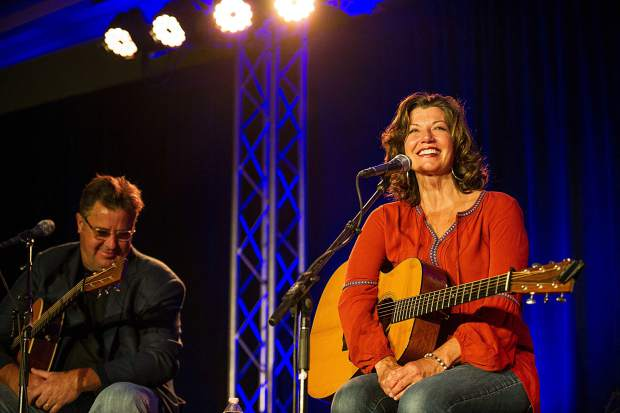 Amy Grant and Vince Gill performing at the Challenge Aspen benefit known as the Vince Gill and Amy Grant 14th Anniversary Gala and Golf Classic at the St. Regis Monday evening.