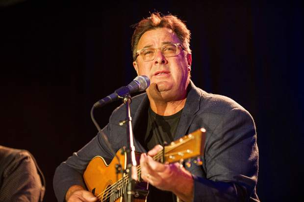 Vince Gill performing at the Challenge Aspen benefit known as the Vince Gill and Amy Grant 14th Anniversary Gala and Golf Classic at the St. Regis Monday evening.