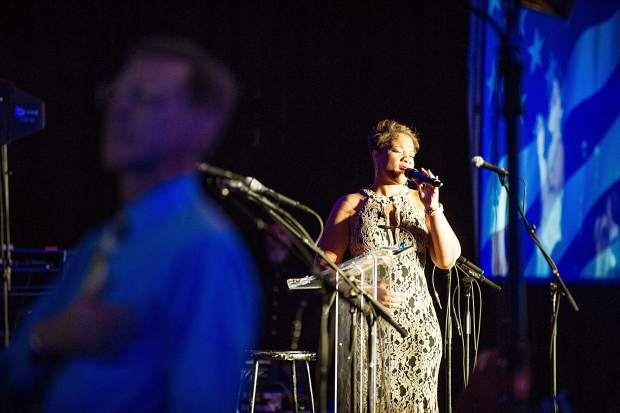 Veteran Zaneta Adams singing the National Anthem at the Vince Gill and Amy Grant 14th Anniversary Gala and Golf Classic at the St. Regis Monday evening.